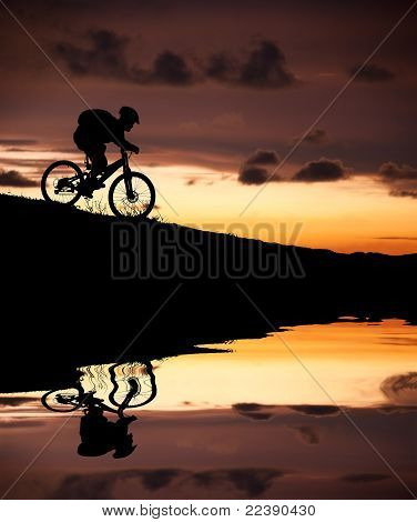 silhouette of mountain biker with Reflection