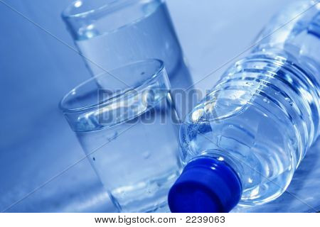 Bottle And Glasses Of Mineral Water