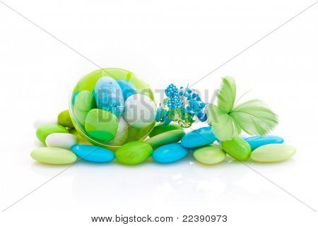 Packet of colored French sugared almonds, ready to use as party favors, on white studio background
