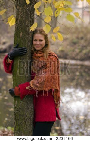 Smiling Woman Hoding The Tree