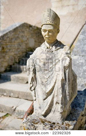 Old French sculpture of a Benedictine munch at the abbey in Tourtoirac