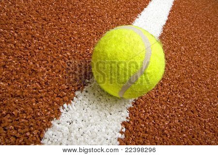 Tennis ball on the court line