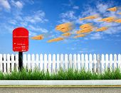 pic of mailbox  - a red postbox and brown envelope with blue sky - JPG