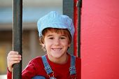 stock photo of caboose  - Little Engineer with Big Smile on a Red Caboose - JPG