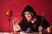 picture of sceptre  - Scary witch with sceptre and crystal ball over red background - JPG