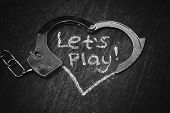 Lets Play Bdsm. Handcuffs For Role-playing. Adult Game Concept. Handcuffs Like Heart With Caption On poster