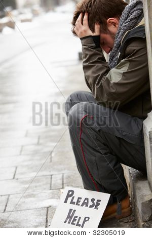 Homeless Young Man Begging In Street
