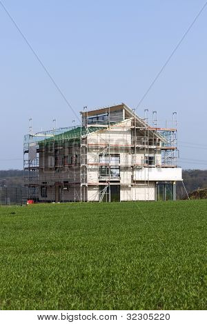 Scaffolding around modern family home under construction.