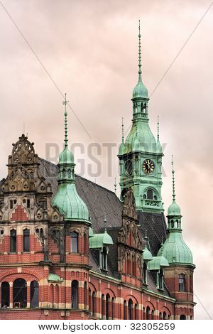 Ornate roof, gables and bell tower on historic office building at  Speicherstadt district, Hamburg