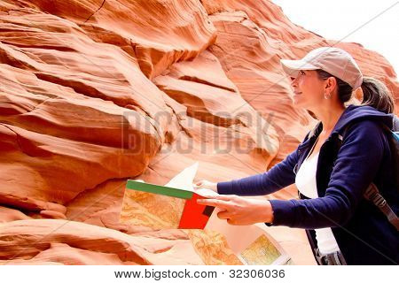 Female tourist at the Grand Canyon holding a map