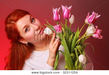 Lovely girl with tulips