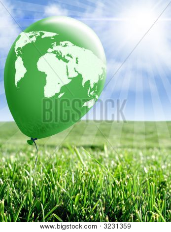 World Map On Green Balloon Over Meadow