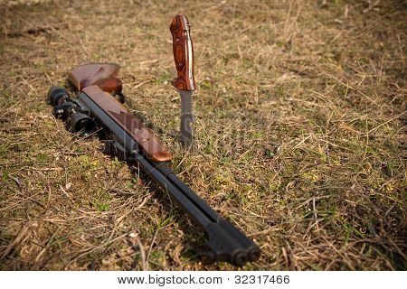 Pneumatic rifle with a knife