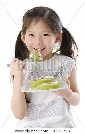 Little Asian girl is enjoying her dessert