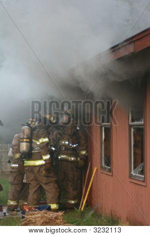 Firemen Entering A Building