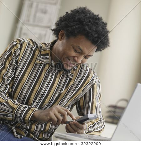African man using cell hone