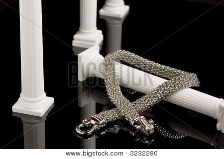 Silver Necklace On Column