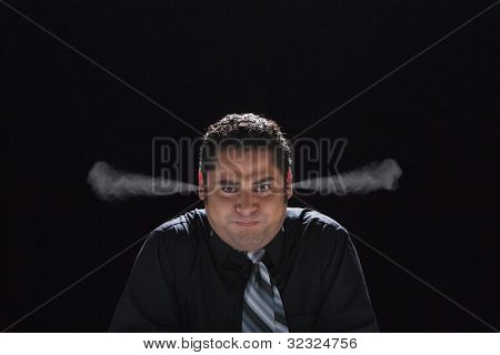 Hispanic businessman with steam coming out of ears