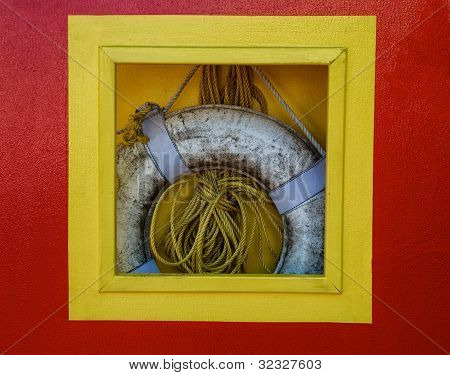 Life Preserver And Rope Hanging In Box On Dock