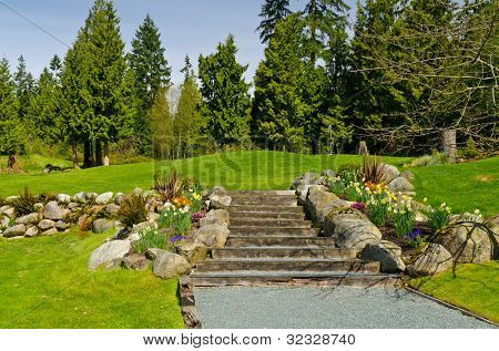 Decorated golf course with stone staircase and green.