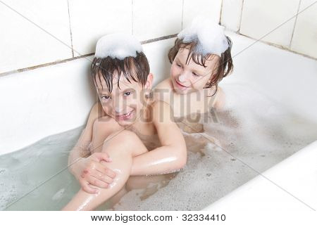 two children having bath