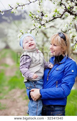 Mother With Child In Blossom Garden