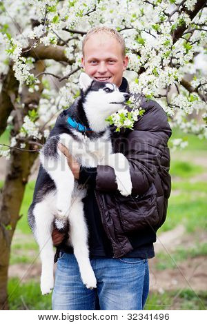 Man With Puppy Husky