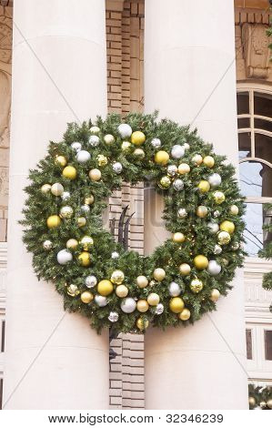 Large Christmas Wreath On Old Columns
