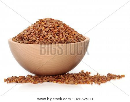 Bilta seed used in chinese herbal medicine in a beech wood bowl over white background. Used as a laxative and sedative.