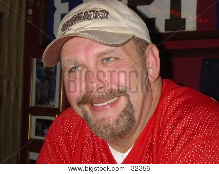 Smiling Man In Sports Bar