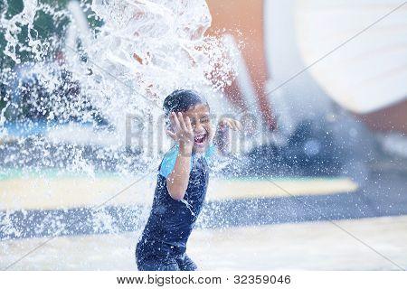 Cute Asian Boy Playing At Waterpark