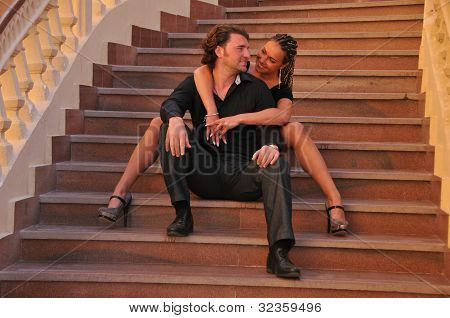 Couple On A Stairway