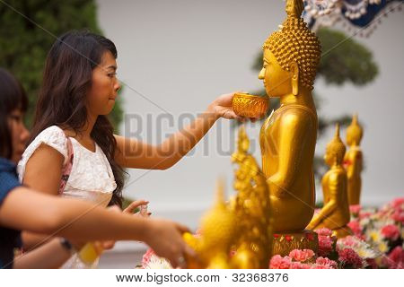 Thai Woman Bathing Buddha Statue
