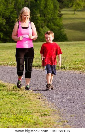 Mother and son jogging for exercise outdoors