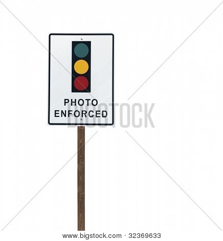 Tall isolated photo enforced signal on a wooden post.