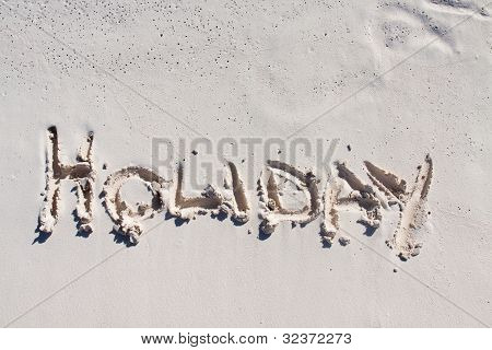 Holiday Written On The White Sand