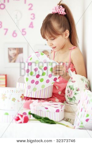 Photo of surprised girl with gifts