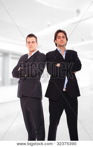 Two Handsome businessmen standing at the office