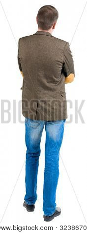 Back view of business man in jacket with patches on the sleeves looking ahead. Isolated over white background.  Standing young guy in jeans. Rear view people collection.  backside view of person.