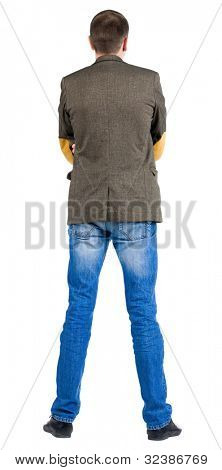 Back view of business man in jacket .  looking on wall. Isolated over white background.  Standing young guy in jeans and suit jacket. Rear view people collection.  backside view of person.