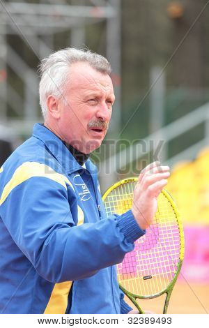 KHARKIV, UKRAINE - APRIL 20: Ukrainian team captain Igor Dernovskyi watch training during Fed Cup Tie between USA and Ukraine in Superior Golf & Spa Resort, Kharkiv, Ukraine at April 20, 2012