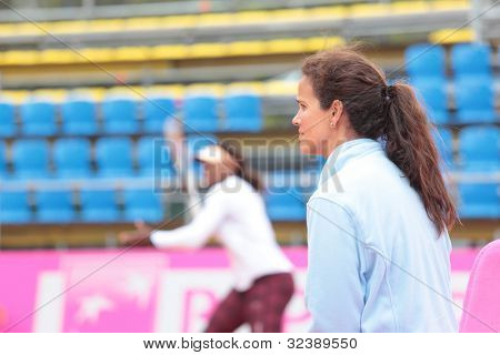 KHARKIV, UKRAINE - APRIL 20: Team captain Mary-Joe Fernandez watch training game during Fed Cup Tie between USA and Ukraine in Superior Golf & Spa Resort, Kharkiv, Ukraine at April 20, 2012