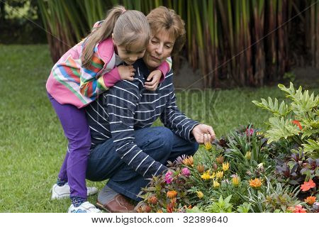 Lovely Grandmother And Granddaughter In Garden