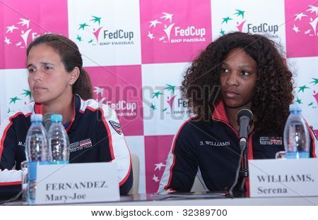 KHARKIV, UKRAINE - APRIL 19: Serena Williams and Mary-Joe Fernandez before Fed Cup Tie between USA and Ukraine in Superior Golf & Spa Resort, Kharkiv, Ukraine at April 19, 2012