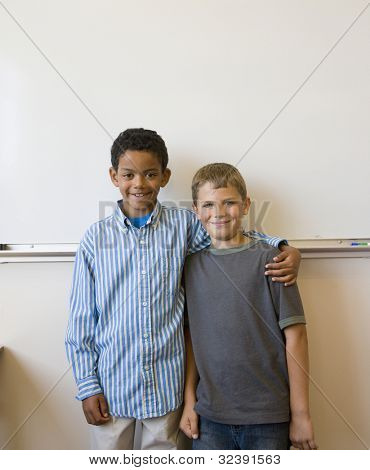 Two boys standing in front of whiteboard