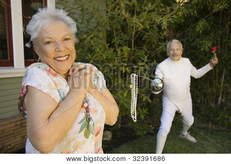 Senior male fencer with pearls at end of epee for senior woman