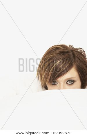 Woman with blanket pulled up over face