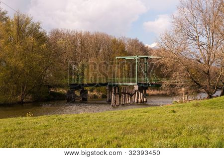 Historic Drawbridge In A Natural Landscape