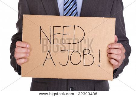 Businessman holding a cardboard sign looking for a job