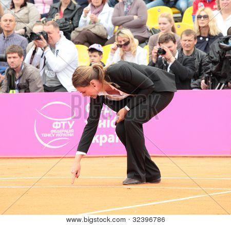 KHARKOV, UKRAINE - APRIL 22: Referee on the court during Fed Cup tie between USA and Ukraine in Superior Golf and Spa Resort, Kharkov, Ukraine at April 22, 2012